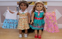 Macie and Daisy as dresses on a clothesline